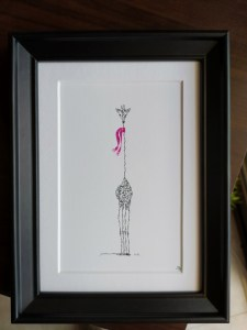 Calligram framed Jiraffe with pink scarf