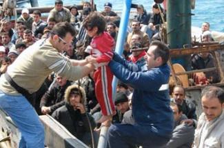 Refugees crammed onto a dinghy.