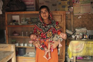 "Child marriage and early motherhood is a prevalent problem in Bangladesh. Girls are betrothed to men they have never met from as early as two years old and, thereafter, get pregnant at the onset of menstruation. There are numerous reasons cited for early marriages, including girls being a financial burden to their (already poor) family; younger girls require a lower dowry payment and marrying to prevent girls from being sexually harassed. Afroza is 17 years old and gave birth to twins two months ago. After delivering her first child, she lost consciousness only to wake up to more labour pains and the surprising news of a second baby on the way. ""You mean at 16 years old, I was carrying two babies in my body? My body is so small, I don't know how I did it."" she expressed. Afroza struggles to eat as she has suffered a loss of appetite and has developed a fear of vomiting since giving birth. She struggles as a young mother and has difficulty in breastfeeding her children due to the lack of breast milk. ""I feel inadequate as a mother. I cannot provide for my babies enough."""