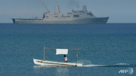 Philippine fisherman observes passing USS Greenbay LPD-20. http://www.channelnewsasia.com/news/asiapacific/philippines-accuses-china/1803246.html