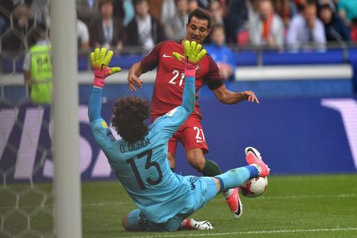 Portugal's defender Cedric finds the net