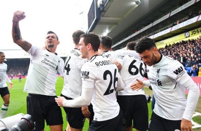 Liverpool's Mohamed Salah celebrates scoring their second goal with Dejan Lovren and team mates