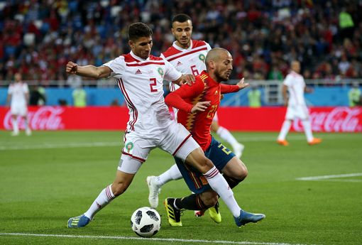 David Silva is challenged by Achraf Hakimi