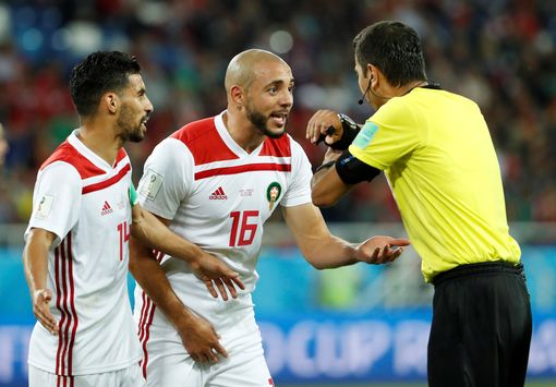 Nordin Amrabat and Mbark Boussoufa protest