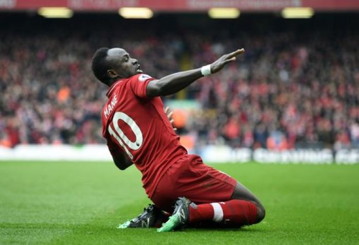 LIVERPOOL, ENGLAND - APRIL 14: Sadio Mane of Liverpool celebrates after scoring his team's first goal during the Premier League match between Liverpool FC and Chelsea FC at Anfield on April 14, 2019 in Liverpool, United Kingdom. (Photo by Michael Regan/Getty Images)