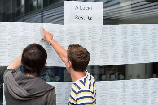 Students check their A-level results at Worcester Sixth Form College, as official figures show that more A-levels were handed the very highest grade this summer, but the overall pass rate fell for the first time in more than 30 years.