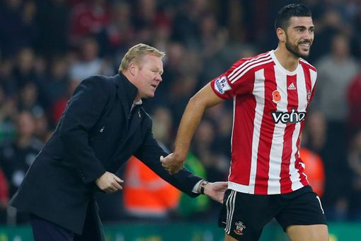 Graziano Pelle celebrates scoring the second goal with manager Ronald Koeman
