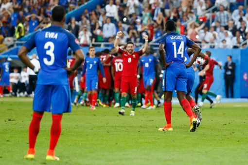 Blaise Matuidi and Patrice Evra react as Portugal celebrate after Eder scored the first goal