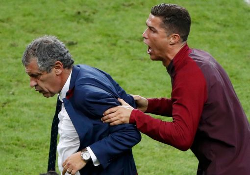 Cristiano Ronaldo and coach Fernando Santos celebrate after winning the match