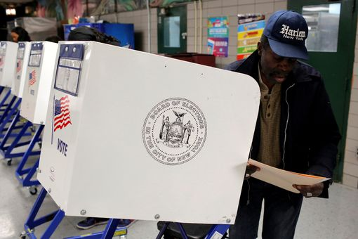 A man fills out a ballot for the U.S presidential election