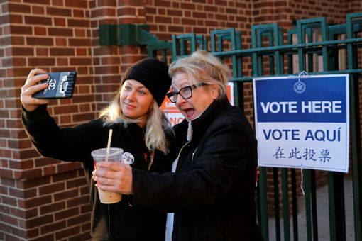 First time voter Kaeli Askea poses for a selfie with her mother