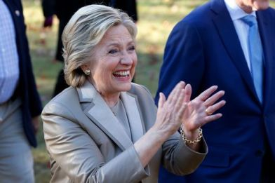 Democratic presidential nominee Hillary Clinton (L) greets supporters after casting her vote in Chappaqua, New York
