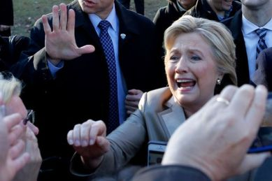 Democratic presidential nominee Hillary Clinton(C)greets supporters after casting her vote in Chappaqua, New York