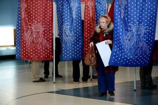 An early morning voter casts her vote at the Bishop Leo E. O'Neil Youth Center on November 8, 2016 in Manchester, New Hampshire