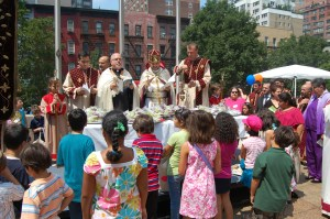 Children gather to witness the Blessing of the Grapes ceremony on the plaza of St. Vartan Cathedral.