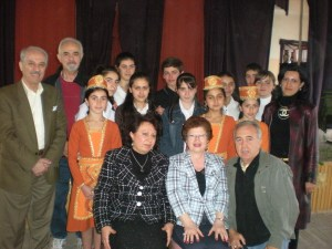 Maro Bedrosian, seated center, with Karabagh School Principal Anahid Kossagyan, Detroit ADL Chairman Hagop Alexanian, students and guests