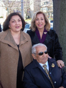 Charles Mosesian is pictured at the unveiling of the exterior sign of the St. James' Charles Mosesian Cultural and Youth Center with his daughters Elaine Mosesian (left) and Charleen Onanian (right).