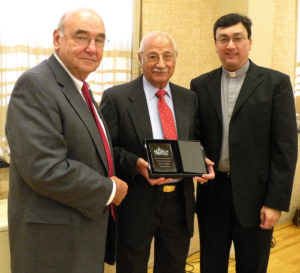 From left, Bruce Newell, Albert Zouranjian and Fr. Vasken A. Kouzouian