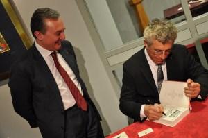 Eric Bogosian signs a book for Amb. Zohrab Mnatsakanyan. Photo credit: Harout Barsoumian