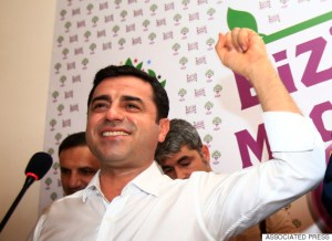 "Selahattin Demirtas, co-chair of the pro-Kurdish Peoples' Democratic Party, (HDP) celebrates following a news conference in Istanbul, Turkey, late Sunday, June 7, 2015. In a stunning blow to President Recep Tayyip Erdogan, preliminary results from Turkey's parliamentary election on Sunday suggested that his party could lose its simple majority in Parliament. Demirtas called his party's ability to cross the threshold a ""fabulous victory for peace and freedoms"" that came despite the attack on his party and fierce campaigning by Erdogan. (AP Photo/Lefteris Pitarakis)"