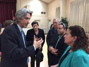 John Prendergast speaks with Arpi Kouzouian and other parishioners.