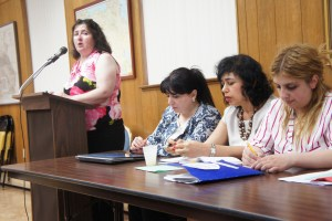 Program Director Alisa Stepanian of CYSCA speaking, with, seated from left, Meri Hakobyan, Anahit Flanagan (interpreter) and Mariana Matosyan (photo Aram Arkun)