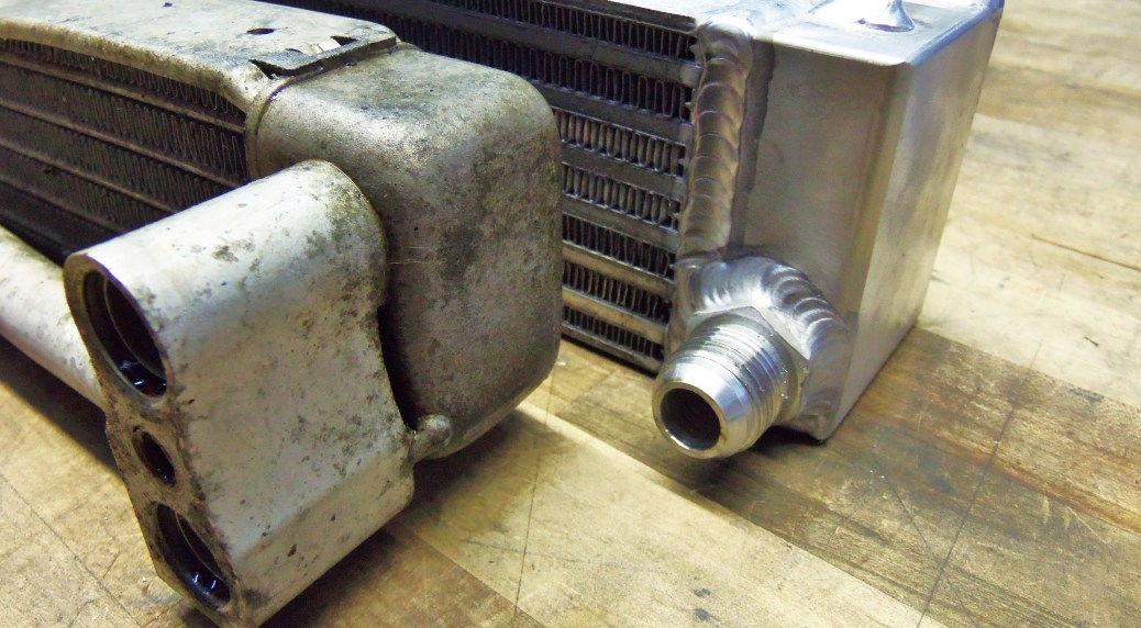 Mishimoto prototype oil cooler (right) and stock oil cooler (left)