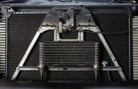 On the 2001-2005 models the cooler is mounted directly in front of the AC condenser, meaning it receives the proper airflow, however the size of the cooler still restricts it's ability to cool the transmission fluid.