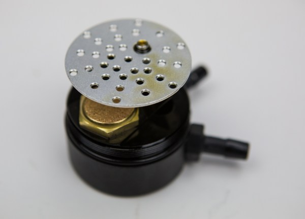 The baffle plate inside of the catch can helps slow the incoming air and aides in the condensation of the oil and fuel particles in the PCV airflow.