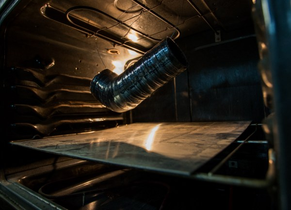 The hose goes through two curing processes. The first cure is to vulcanize the silicone. By being heated in the oven for an hour at 225°F, the silicone will go from a soft malleable material to a solid, holding its shape enough that the mold and binding tape can be removed. The second cure is more of an aging process, where after 4 hours at 350°F the silicone will not degrade or discolor, even after repeated pulls on our dyno.