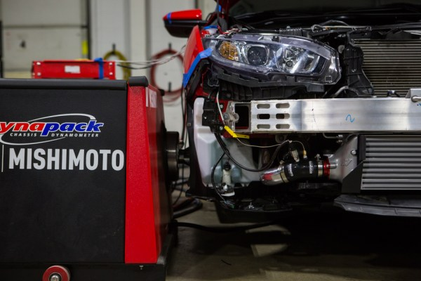 You may notice the excess of wires stemming from our loaner Civic. While it may seem like we are recreating Frankenstein's monster, we are actually capturing and recording as much data as possible to deliver the most accurate dyno results.
