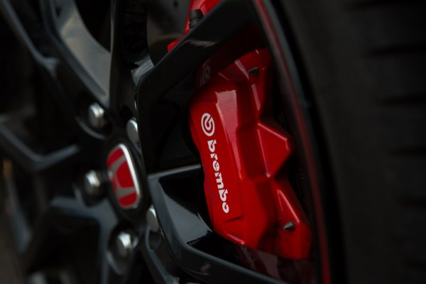 Honda included some serious 4-piston Brembo brake calipers, which help in the Type R's supreme handling. The thing with brakes, especially the fronts, is that they also get ridiculously hot and need some extra cooling, which is what that duct work is for. Even after removing the factory duct and placing a cooler in front of the air channel, lopsided brake fade is not something you'll need to worry about. The aero on the car is still directing plenty of air into the wheel wells to cool and blow away dust, keeping the stopping power right where it needs to be.