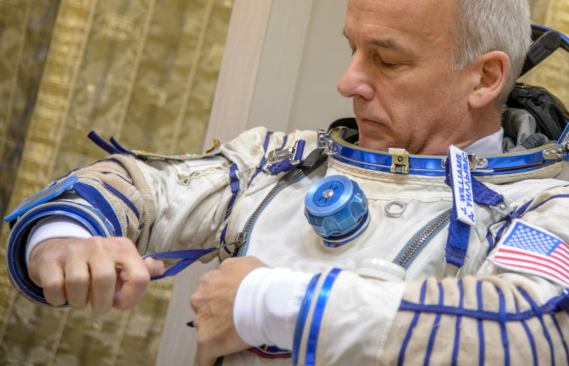 Expedition 47 NASA astronaut Jeff Williams dons his Russian Sokol suit on his final day of Soyuz qualification exams with Russian cosmonauts Oleg Skripochka, and Alexei Ovchinin of Roscosmos, Thursday, Feb. 25, 2016, at the Gagarin Cosmonaut Training Center (GCTC) in Star City, Russia. Photo Credit: (NASA/Bill Ingalls)