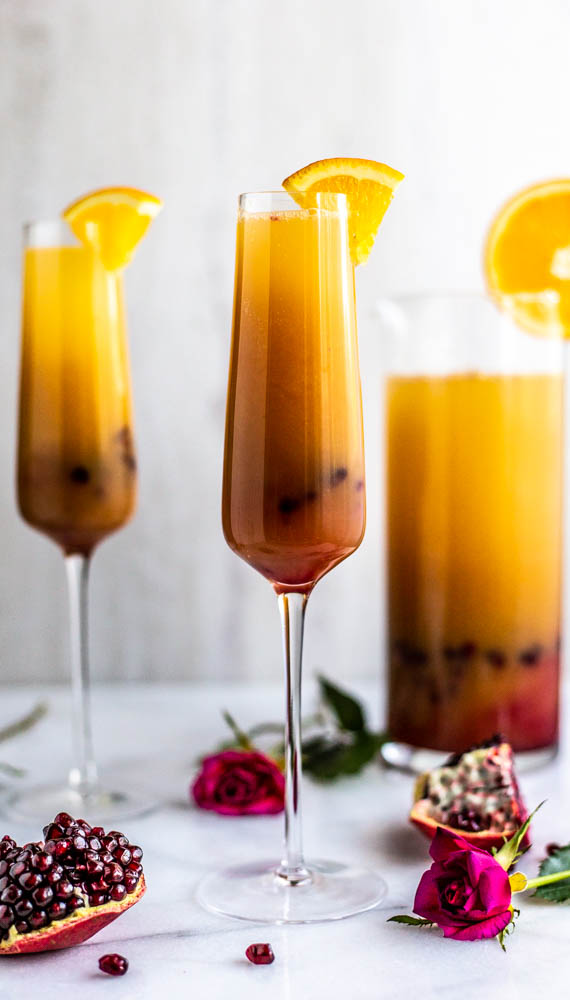 Serving up this Refined Sugar Free Tequila Sunrise Punch with lightly, agave sweetened pomegranate juice, OJ and of course, tequila.