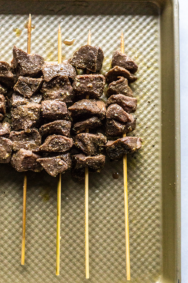 venison skewers marinated on a sheet pan