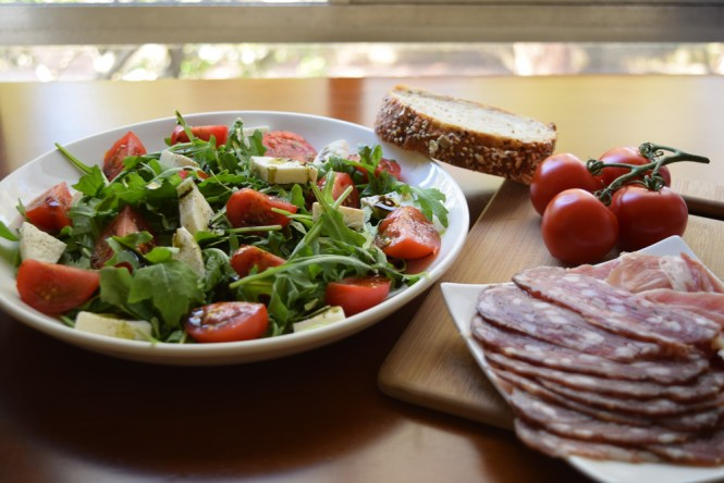 Tomato and Mozzarella salad with pumpkin seed oil served
