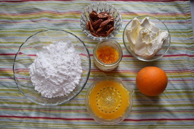 ingredients for decorating orange, carrot, and pecan cake