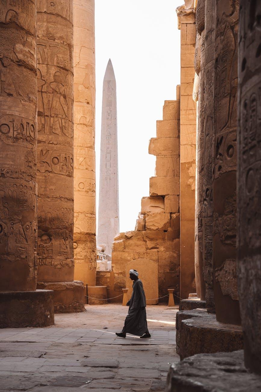 person walking near columns