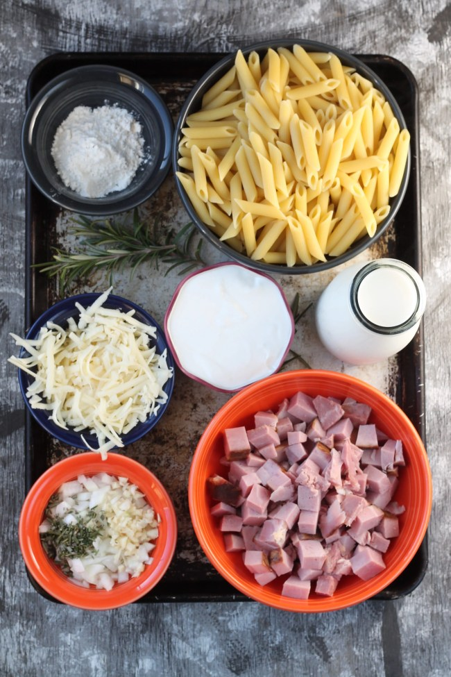 Ingredients for Baked Penne Pasta, ham, pasta, onion, garlic, rosemary, flour, milk, sour cream, swiss cheese