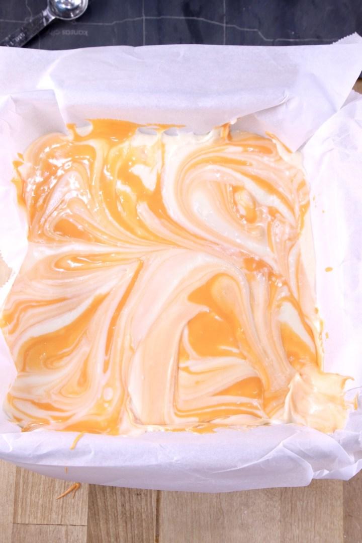 Marbled Orange Cream Fudge in a pan