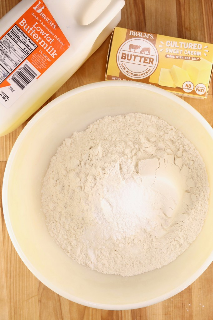 Bowl of flour with butter and buttermilk for biscuits