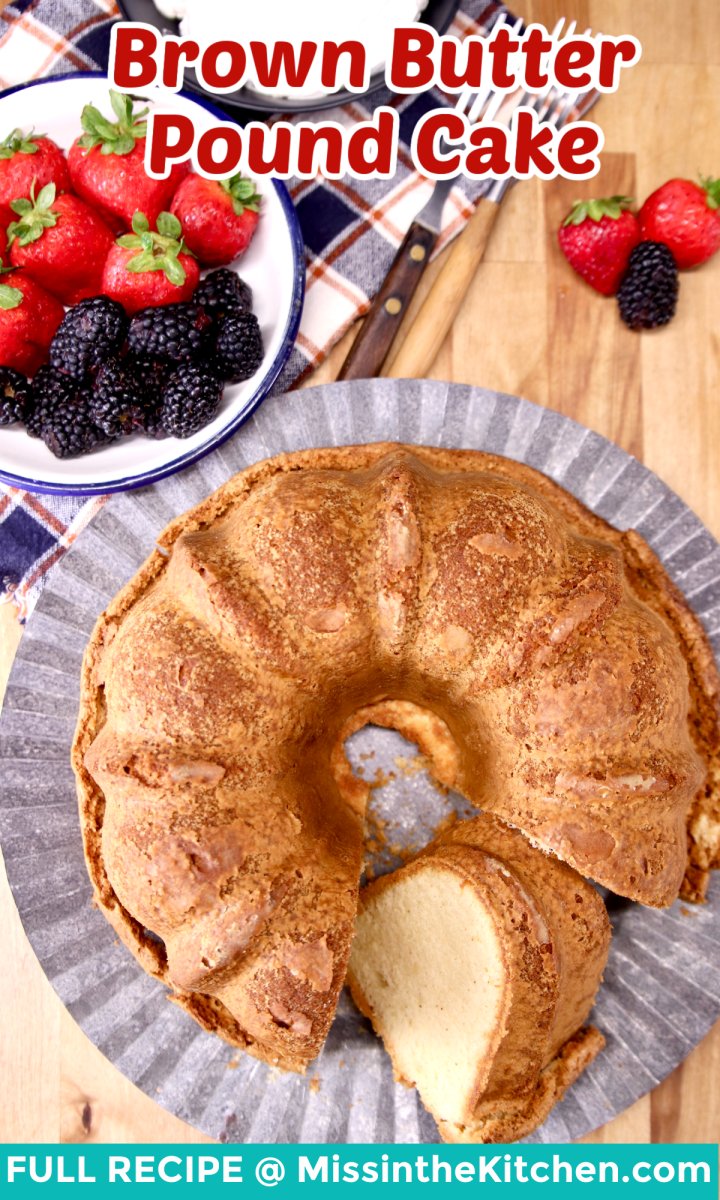 brown butter pound cake on cake plate, bowl of berries - text overlay