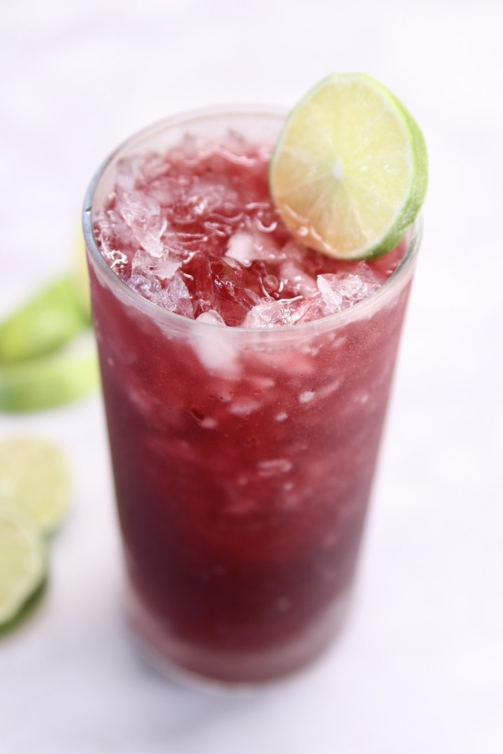 Pomegranate Margarita Cocktail with lime garnish