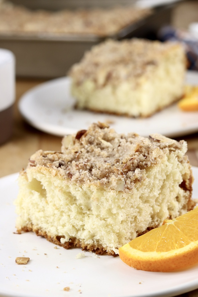 Almond Streusel Coffee Cake - 2 servings on plates with orange slices