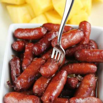 Little Smokies with Grape Jelly Chili Sauce crock pot recipe served with pineapple