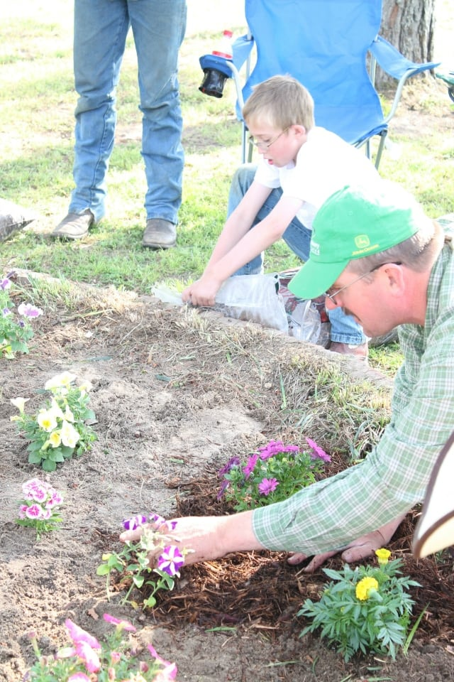 tony and emmet planting flowers