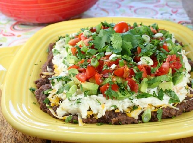 Artichoke & Jalapeño 7 Layer Mexican Dip recipe from missinthekitchen.com