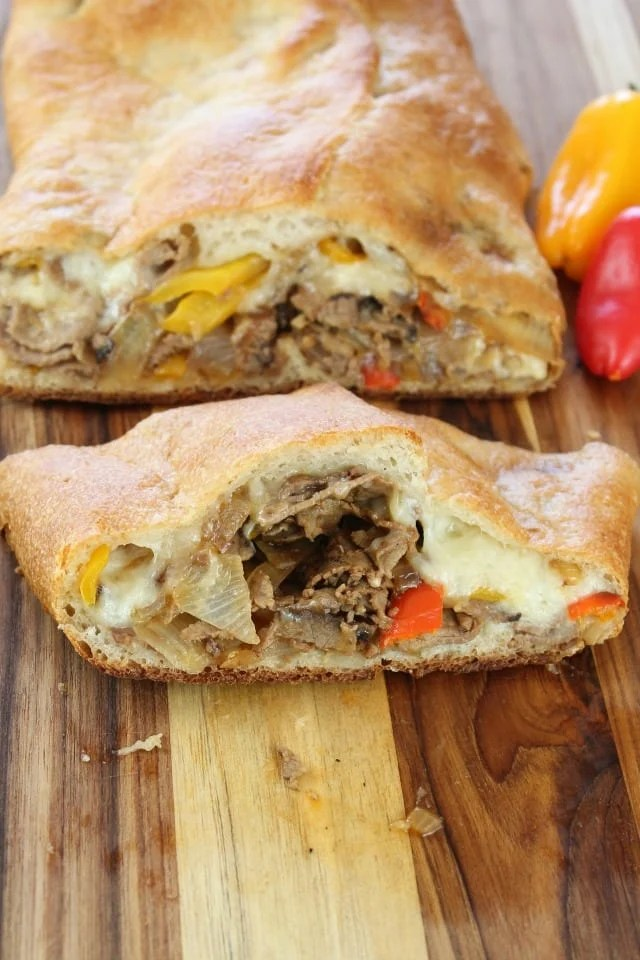 Easy Cheesesteak Stromboli is a quick and delicious family-friendly meal.  Ready in just 30 minutes.  From Miss in the Kitchen