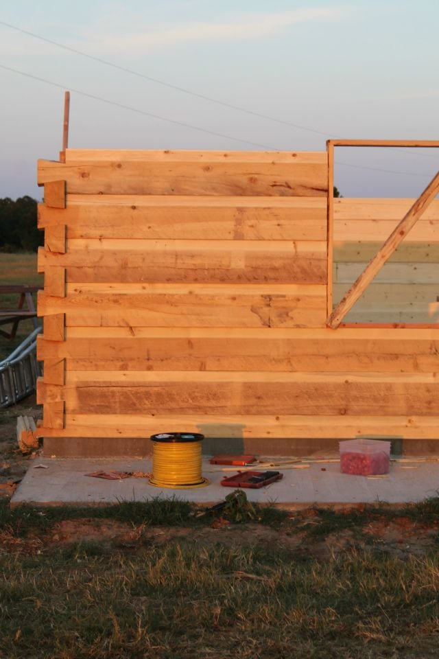 Progression of Log Wall for Log Cabin Saturday #2 Miss in the Kitchen