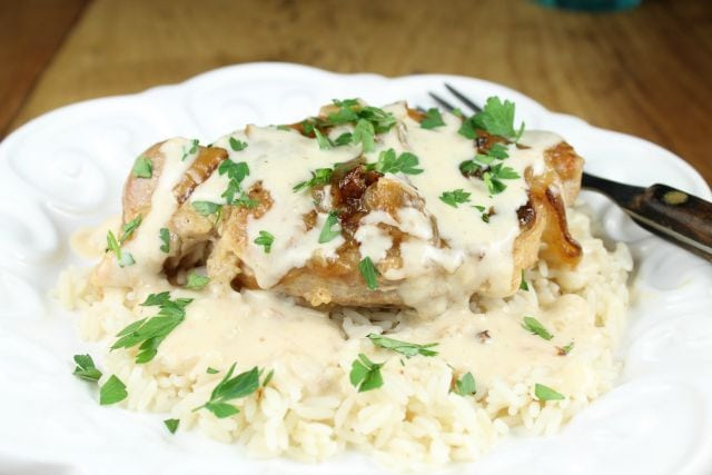 Slow Cooker Smothered Pork Chops with Sour Cream Sauce from missinthekitchen.com